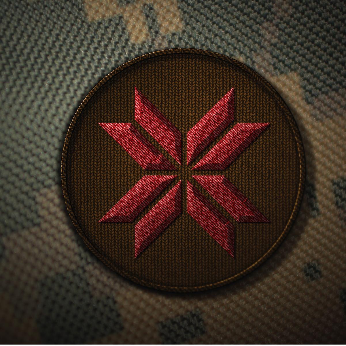 Нарукавная эмблема 43 бригады. Благодаря своей лаконичности крест перуна также легко считывается как и тысячу лет назад.